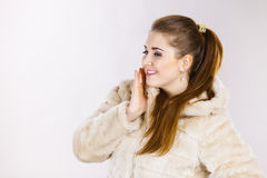 Happy attractive woman wearing furry coat Royalty Free Stock Photo