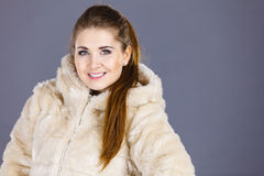 Happy attractive woman wearing furry coat Stock Photography