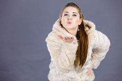 Happy attractive woman wearing furry coat Royalty Free Stock Photography