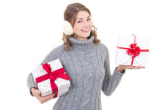 Happy attractive woman in woolen sweater and muffs with christma Royalty Free Stock Images