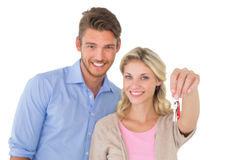 Happy attractive young couple holding new house key Royalty Free Stock Photo