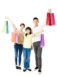 Happy Attractive Young  Family with shopping bags Stock Photo