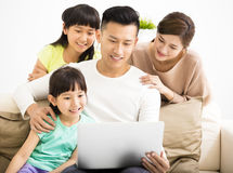 Happy Attractive Young  Family watching the laptop. Happy Attractive Young asian Family watching the laptop Stock Photos