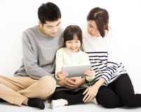 Happy Attractive Young  Family watching the tablet. Happy Attractive Young asian Family watching the tablet Royalty Free Stock Photos