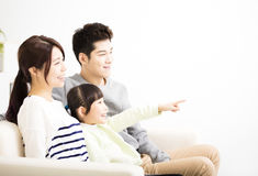 Happy Attractive Young  Family watching the tv Stock Photography