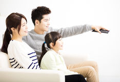 Happy Attractive Young  Family watching the tv Stock Images