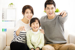Happy Attractive Young  Family watching the tv Royalty Free Stock Photo