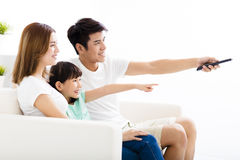 Happy Attractive Young  Family watching the tv. Happy Attractive Young asian  Family watching the tv Royalty Free Stock Images