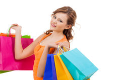 Happy attractive young shopaholic Stock Images