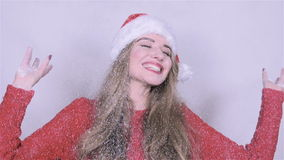 Happy attractive young woman in Christmas cap, snowfall background. stock footage
