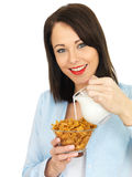 Happy Attractive Young Woman Eating Breakfast Cereals Stock Photo