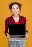 Happy attractive young woman holding blank screen laptop Royalty Free Stock Photos