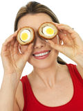 Happy Attractive Young Woman Holding a Cooked Scotch Egg Savory Stock Photos