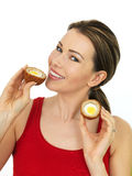 Happy Attractive Young Woman Holding a Cooked Scotch Egg Savory Royalty Free Stock Photo