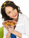 Happy Attractive Young Woman Holding a Plate of Spaghetti Meatballs Royalty Free Stock Photos