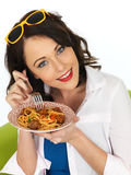 Happy Attractive Young Woman Holding a Plate of Spaghetti Meatballs Stock Image