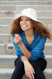 Happy and attractive young woman laughing outdoors Royalty Free Stock Image