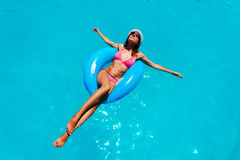 Free Happy Attractive Young Woman Swim In The Pool Royalty Free Stock Image - 79664786