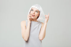 Happy attractive young woman talking on cell phone Stock Photos