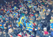 Happy audience with swedish flags in the parallel slalom event Stock Photo