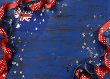 Happy Australia Day, January 26, theme dark blue vintage distressed wood background. With Australian flag and decorations with copy space for your text here stock photos