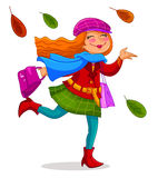 Happy autumn. Happy woman carrying shopping bags under falling autumn leaves Royalty Free Stock Photography