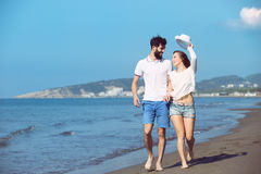 Happy autumn fall couple showing with outstretched arms Stock Photo