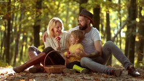 Happy Autumn Family. Enjoying nice weekend together. Family parenthood and people concept - happy mother father and. Little boy in autumn park stock footage