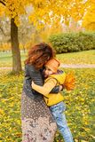 Happy Autumn Mother and Child Boy Hugging Stock Photography