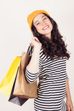 Happy autumn or winter girl with wool cap shopping Stock Images