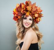 Happy autumn woman in fall leaves crown on gray background.  royalty free stock images