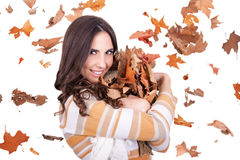 Happy autumn woman with falling leaves Stock Image
