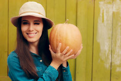 Happy Autumn Woman Holding Pumpkin Stock Images