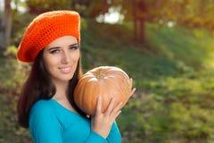 Happy Autumn Woman Holding Pumpkin Royalty Free Stock Photos