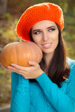 Happy Autumn Woman Holding Pumpkin Royalty Free Stock Photo