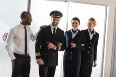 Happy aviation personnel team. In professional uniform royalty free stock photos