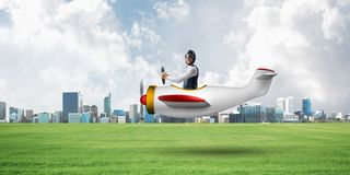 Happy aviator driving small propeller plane royalty free stock images