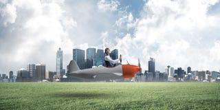 Happy aviator driving small propeller plane royalty free stock photo