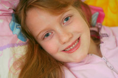 Happy awake girl. Happy children wake up and smiling to me Royalty Free Stock Photo