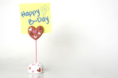 Happy B-Day. Close up of a postit note saying Happy B-day isolated on white Stock Photography