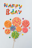Happy B-day lollipop candy sweets bouquet. Holiday baloons conce. Pt. White background Stock Image