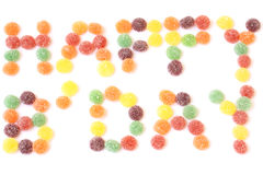 Happy b'day text. Out of candied sweets isolated on a white background Stock Photography