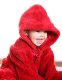 Happy baby. Smiling baby with red hood over white background Stock Images