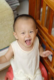 Happy baby. A Chinese baby is in home. He is very happy Stock Photography