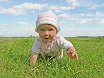 Happy baby. In summer meadow Stock Photo