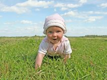 Happy baby. In summer meadow Stock Images