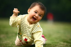 Happy baby. This is a baby girl. she is playing now. very happy Stock Photo