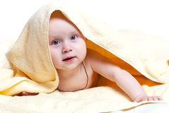 Happy baby. With a towel Stock Images