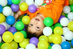 Happy baby. This is a baby girl. she is playing on the ball pond now. very happy Stock Images
