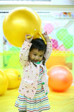 Happy baby. This is a baby girl. she is playing on the ball pond now. very happy Stock Photos